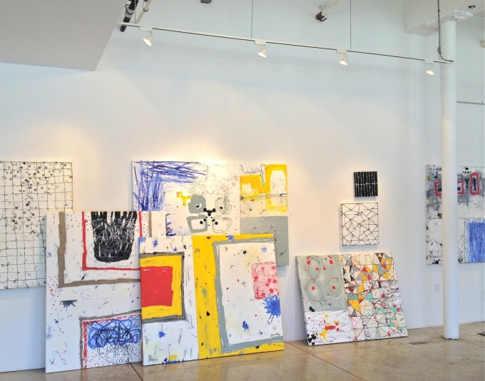 New Paintings Stacked against The Wall In The Wooltex Gallery